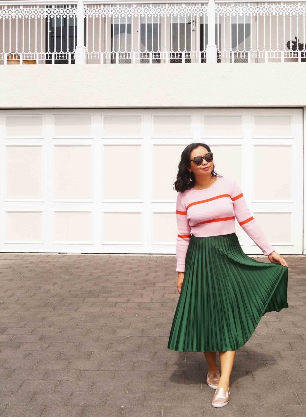 pink top and green skirt outfit